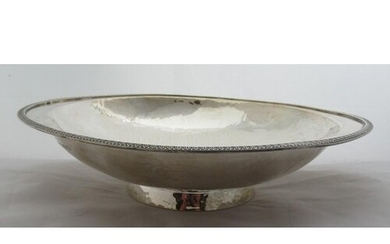A Hukin & Heath oval silver bowl, with embossed edge and ham...