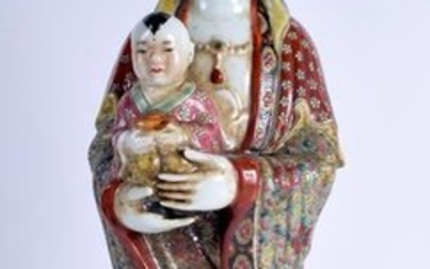 A LARGE CHINESE PORCELAIN FIGURE OF GUANYIN, formed