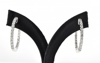 A PAIR OF DIAMOND HOOP EARRINGS Each earring comprising twenty round brilliant cut diamonds, altogether totalling 1.61cts, in 18ct w...