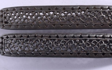 A PAIR OF MIDDLE EASTERN SILVER BUCKLE, reticulated in