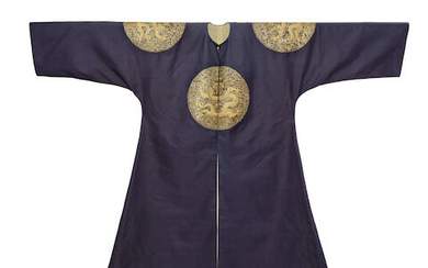 A RARE IMPERIAL MIDNIGHT-BLUE GOLD AND SILVER COUCHED PRINCE'S SURCOAT, BUFU