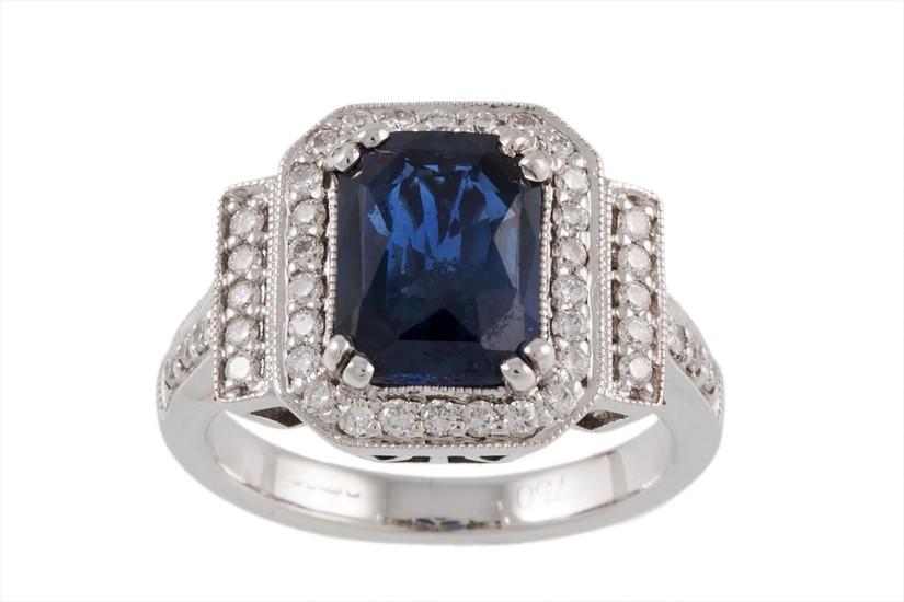 A SAPPHIRE AND DIAMOND CLUSTER RING mounted in 18ct white go...