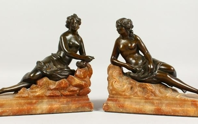 A SUPERB PAIR OF BRONZE NUDE FIGURES laying on an