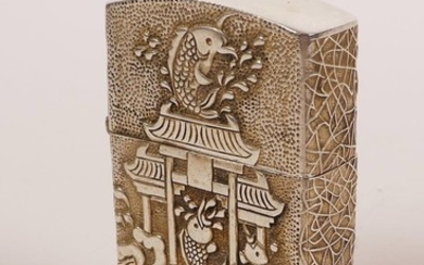 A Zorro lighter in a Chinese white metal case decorated with...