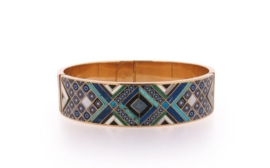 A gem-set gold bangle, of mosaic design, inlaid with hardstone panels, mother-of-pearl and paste in gold, signed Jierre VE 78, 7cm wide, 82g