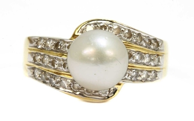 A gold cultured pearl and diamond ring