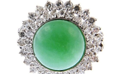A jade and diamond cluster ring. Estimated total...