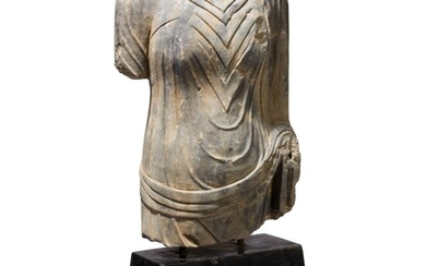 A life-sized torso of a Buddha statue, probably Gandhara, 1st - 3rd century