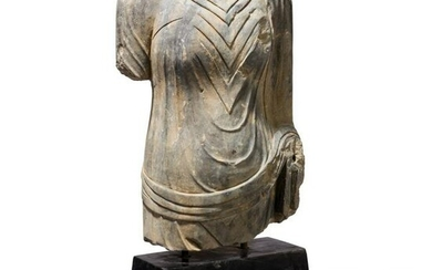 A life-sized torso of a Buddha statue, probably