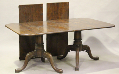 A modern 18th century style solid oak twin-pedestal dining table by Bylaw, the top with two extra le