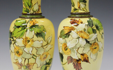 A pair of Doulton faience pottery vases, circa 1882, each ovoid body decorated by Mary M. Arding, mo