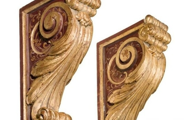 A pair of carved, painted and partly gilded southern