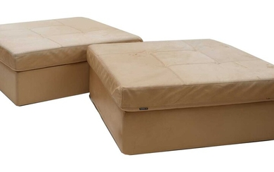 A pair of tan leather pouffes