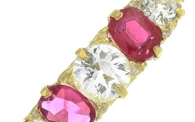 A ruby and diamond five-stone ring.Total ruby weight