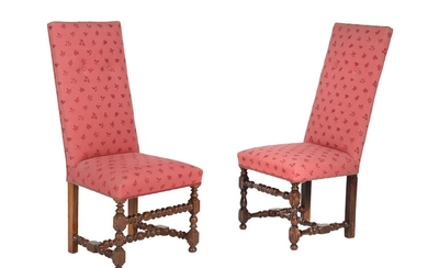 A set of eight walnut and upholstered dining chairs