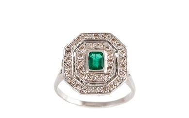 AN EMERALD AND DIAMOND CLUSTER RING, the octagonal cut emera...