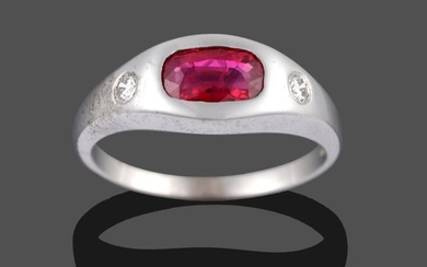 An 18 Carat White Gold Ruby and Diamond Three Stone...