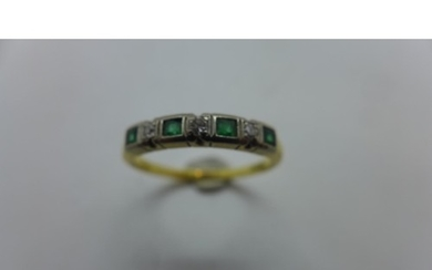 An 18ct gold diamond and emerald ring, size Q, approx 2.8 gr...