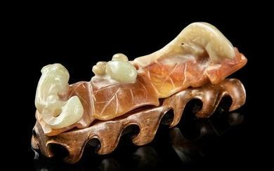 CELADON JADE WITH RUSSET SKIN BRUSH REST QING DYNASTY