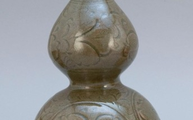 """CHINESE LONGQUAN CELADON PORCELAIN DOUBLE GOURD-FORM VASE Incised floral decoration. Height 9.5""""."""