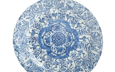 Chinese blue and white porcelain dish with scallop rim. Artemisia leaf to the bottom. 19th century. Diam. 30 cm.