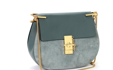 """Chloé: A """"Drew"""" bag made of blue leather and suede, gold toned hardware, chain strap and a pocket inside."""