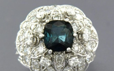 Cocktail ring with sapphire and diamonds