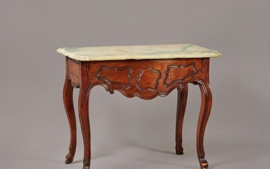 Console table in carved walnut with a slightly curved front underlined by reserves. It has a side drawer and rests on four curved legs ending in hooves. Provincial work from the end of the 18th century. Marble top. (Restorations and transformations)...