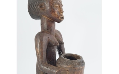 EARLY AFRICAN CARVED WOOD FIGURE of a woman seated holding a...