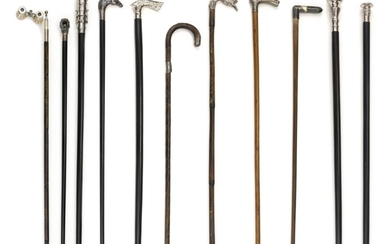 ELEVEN STERLING SILVER, SILVER PLATED AND SILVER-TONE CANES 1) Sterling silver handle formed as horse heads. 2) Sterling silver hand...