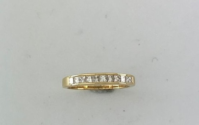 Half wedding band in gold 750°/°° decorated with...