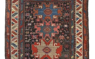 Karabagh with Lesghi stars Caucasus, c. 1900, wool on wool, 4 Lesghi stars and scattered motifs as well as small bird and quadruped abstractions on a black field, so-called saw blade wine glass border and a geometrically abstract vine border, LxW:...
