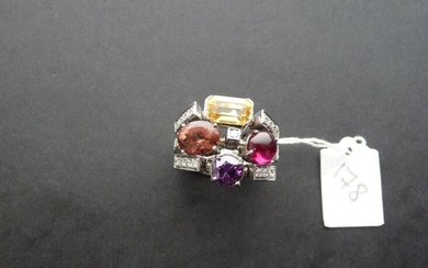 Ring in 18K (750/oo) white gold forming three rings decorated...