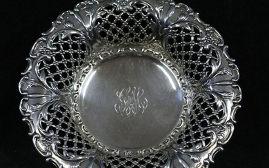 Round basket in silver, openwork edge with crosses and embossed...