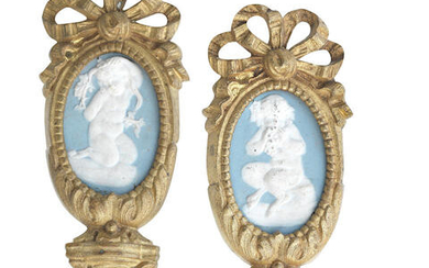 Two 19th century gilt brass and wedgewood style porcelain curtain tie backs