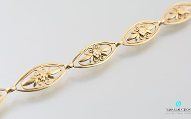 Yellow gold bracelet filigree mesh decorated with flowers...