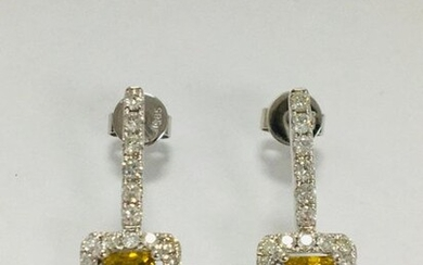 14ct White Gold Diamond drop earrings featuring centre,...