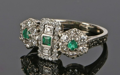 18 carat white gold, emerald and diamond set ring, the