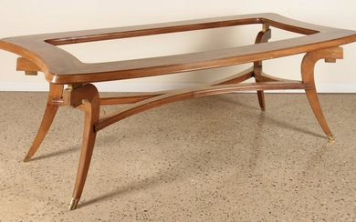 A MID CENTURY MODERN DINING TABLE WITH FLARED LEG