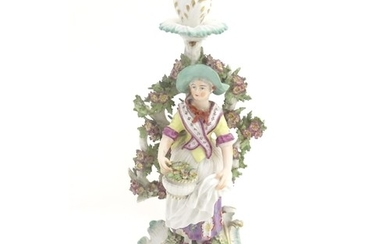 A 19thC candlestick bocage figure, depicting a woman with a ...