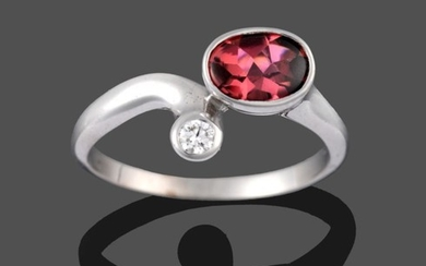 A 9 Carat White Gold Garnet and Diamond Ring, the...