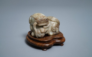 A Chinese pale grey brown jade model of...