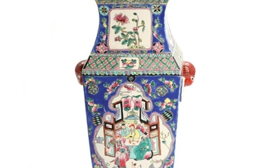 A Chinese porcelain vase, decorated in enamel colours with figures, birds and plants. Marked Tongzhi, but 20th century. H. 40 cm.