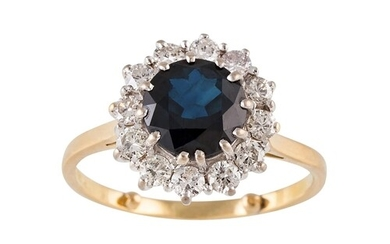 A DIAMOND AND SAPPHIRE CLUSTER RING, of circular form, mount...