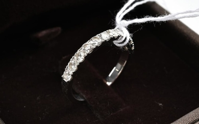 A DIAMOND HALF HOOP RING BY CARA IN 18CT WHITE GOLD