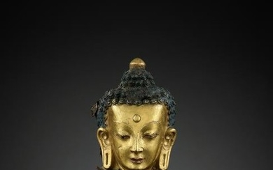 A GILT COPPER REPOUSSE HEAD OF BUDDHA, 18TH CT