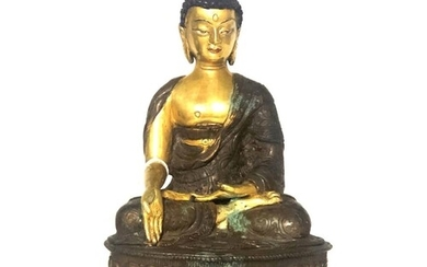 A LATE 19TH/EARLY 20TH CENTURY SINO-TIBETAN GILT BRONZE BUDD...