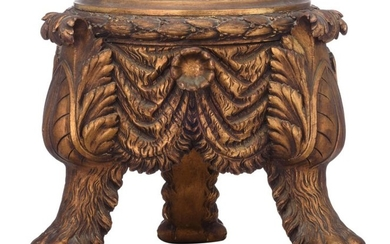 A Neoclassical gilt wooden carved lion paw tripod...