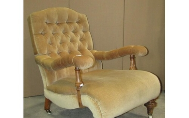 A Victorian drawing room/library chair with deep buttoned ba...