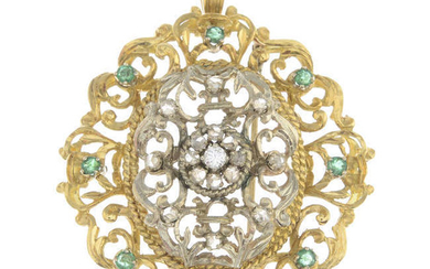 A diamond and emerald foliate pendant.